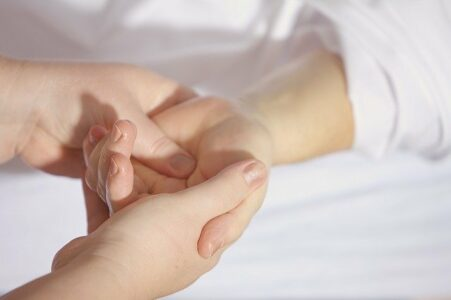 Hands showing pressure point therapy